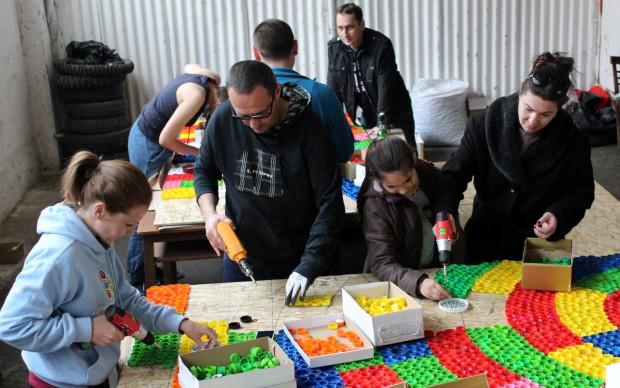street art installation plastic bottle caps